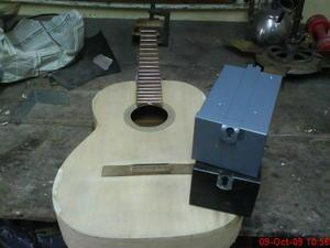 reparar guitarra acustica